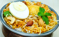 Egg Biryani. Biryani, biriani, or beriani is a set of rice-based foods made with spices, rice (usually basmati) and meat, fish, eggs or vegetables royalty free stock images