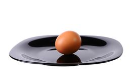 Egg on a black plate Royalty Free Stock Photo