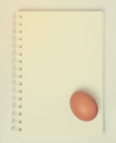 An Egg on a Blank Notebook page Stock Photos