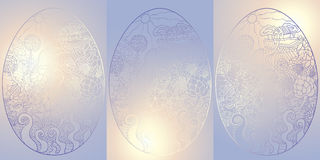 Egg1blue gradient card. Easter egg painted with a rural landscape and flowers on a background of solar rays of sunset Royalty Free Stock Photo