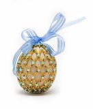 Egg with blue ribbon. Isolated on white background Royalty Free Stock Image