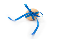 Egg with blue ribbon and bow Stock Photo