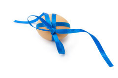 Egg with blue ribbon and bow Royalty Free Stock Photography