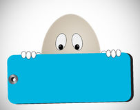 Egg with blue tag Stock Photography