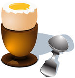 Egg_boiled. Boiled  egg with spoon Royalty Free Stock Photos