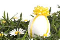 An egg with a bow Royalty Free Stock Image
