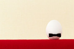 Egg with a bow on a light background Stock Photography