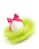 Egg with bow is in the nest of sisal material Stock Image