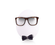 Egg in bow tie with glasses isolated on white Stock Photo