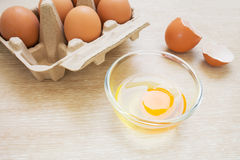 Egg in bowl with egg carton Royalty Free Stock Image