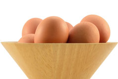 Egg in bowl. Egg in the wooden bowl Stock Images