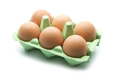 Egg box. Eggs in green box isolated on white background stock photography