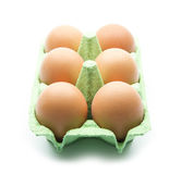 Egg box. Eggs in green box isolated on white background Royalty Free Stock Photo