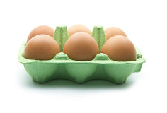 Egg box. Eggs in green box isolated on white background Royalty Free Stock Image