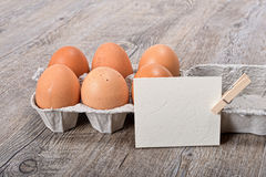Egg box with a label Stock Photography