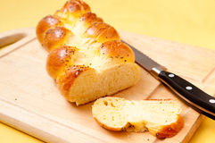 Egg bread challah. Golden brown home made challah egg bread and buns Stock Images