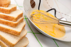 Egg and bread prepared for french toast Stock Photo