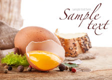 Egg and bread on a wooden table Royalty Free Stock Image
