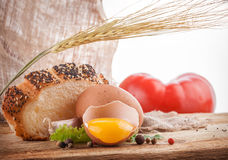 Egg and bread on a wooden table Royalty Free Stock Photo