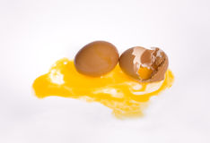 Egg and Broken Eggshell. Hen Egg lay on Isolate Background . One is Broken Eggshell. Show Yellow York Royalty Free Stock Photos