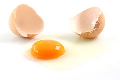 Egg broken isolated Stock Images