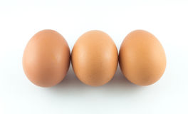 Egg. Brown background raw white Stock Photos