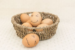Egg in a brown Basket. Two egg in a brown Basket and happy egg stock photography