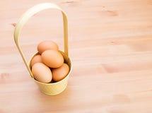 Egg in bucket Royalty Free Stock Photos