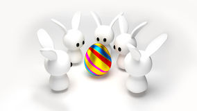 Egg and Bunnies. Some toy bunnies around an easter egg Stock Illustration