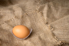 Egg on burlap material Royalty Free Stock Images
