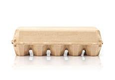 Egg a caixa de molde de papel de empacotamento isolada no fundo branco Imagem de Stock Royalty Free