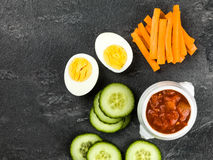 Egg Carrot and Cucumber Crudites With Tomato Salsa. Against a Balck Background Royalty Free Stock Images