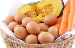 Egg carrot and pumpkin. Egg fresh carrot and a piece of pumpkin in basket Royalty Free Stock Photos