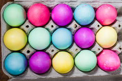 Egg carton of colorful dyed Easter eggs Stock Image