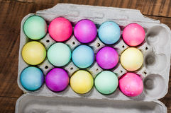 Egg carton of colorful dyed Easter eggs Royalty Free Stock Image