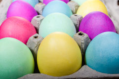 Egg carton of colorful dyed Easter eggs Royalty Free Stock Photography