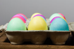 Egg carton of colorful dyed Easter eggs Royalty Free Stock Photo