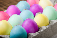 Egg carton of colorful dyed Easter eggs Royalty Free Stock Images