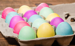Egg carton of colorful dyed Easter eggs Royalty Free Stock Photos