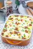Egg casserole with potatoes, sausage and pepper, in baking dish Royalty Free Stock Photography