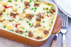 Egg casserole with potatoes, sausage and pepper, horizontal Stock Images