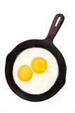 Egg on a cast-iron pan Stock Image