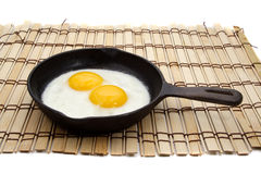 Egg in a cast iron pan Royalty Free Stock Photo