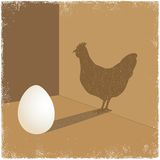 Egg casting shadow of chicken Stock Photos