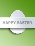 Egg centered with Happy Easter text on green Stock Photo