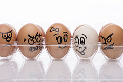 Egg characters. Displaying angry emotions towards egg couple Stock Photo