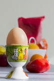 Egg in a cheerful holder Stock Image