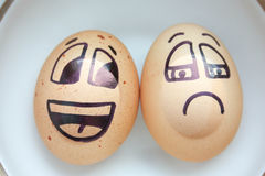 Egg with a cheerful painted face. Photo Royalty Free Stock Images