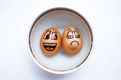 Egg with a cheerful painted face. Photo Stock Images