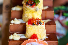 Egg and cheese roll with salmon egg sushi Japanese food Stock Images